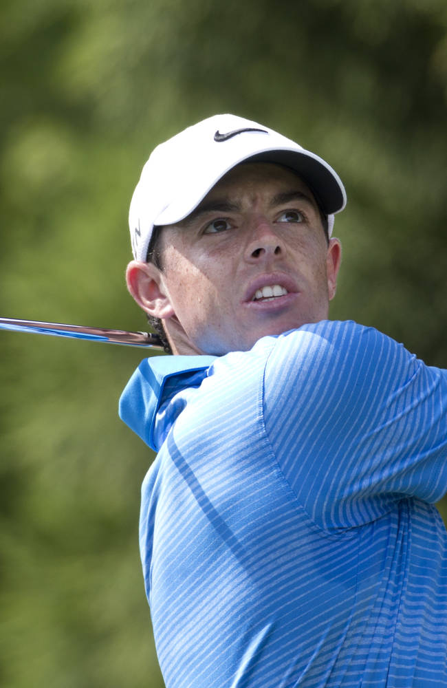 Rory McIlroy, of Northern Ireland,  hits from the tee on the second hole during the third round of play in the Tour Championship golf tournament  Saturday, Sept. 13, 2014, in Atlanta. (AP Photo/John Bazemore)