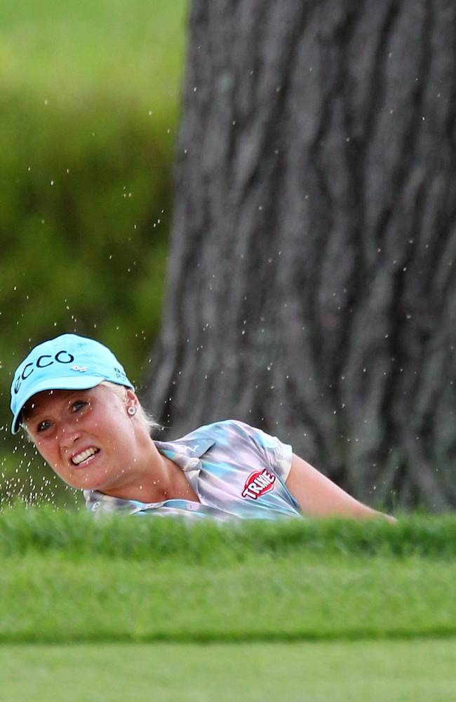 Line Vedel, of Denmark, blasts out of a bunker on the 14th hole at the Canadian Pacific Women's Open golf tournament in London, Ontario, Thursday, Aug. 21, 2014
