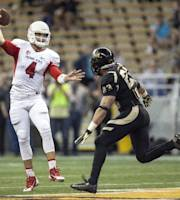 Fresno State quarterback Derek Carr (4) throws pass as Idaho linebacker Marc Millan (23) defends during the first half of an NCAA college football game Saturday, Oct. 5, 2013, in Moscow, Idaho. (AP Photo/Dean Hare)