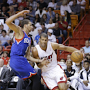 Miami Heat forward Shane Battier, right, drives to the basket past Philadelphia 76ers guard Michael Carter-Williams during the first half of an NBA basketball game on Wednesday, April 16, 2014, in Miami The Associated Press