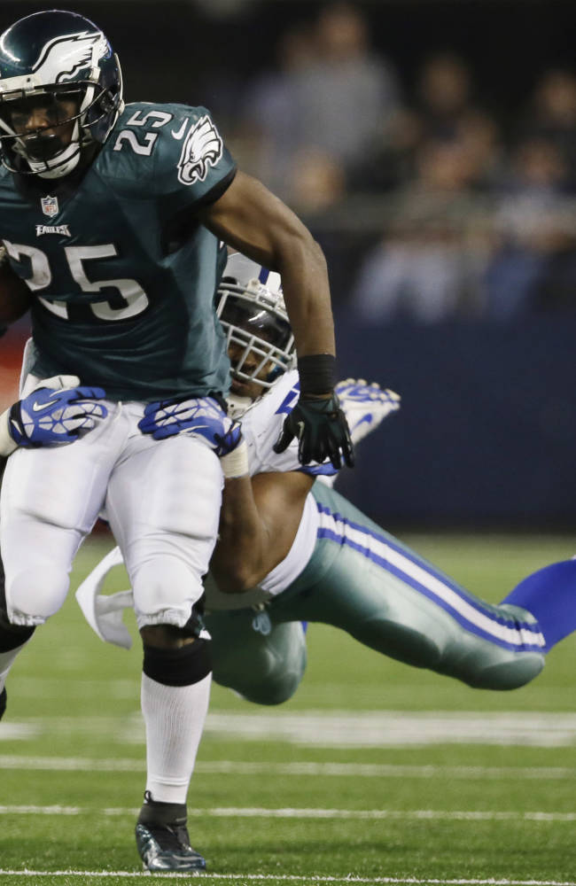 Philadelphia Eagles running back LeSean McCoy (25) is tackled by Dallas Cowboys middle linebacker DeVonte Holloman (57) during the second half of an NFL football game, Sunday, Dec. 29, 2013, in Arlington, Texas
