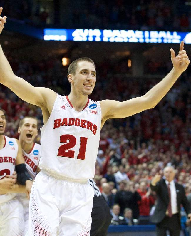 Wisconsin's Josh Gasser (21) celebrates after a a third-round NCAA college basketball game against Oregon, Saturday, March 22, 2014, in Milwaukee. Wisconsin won 85-77