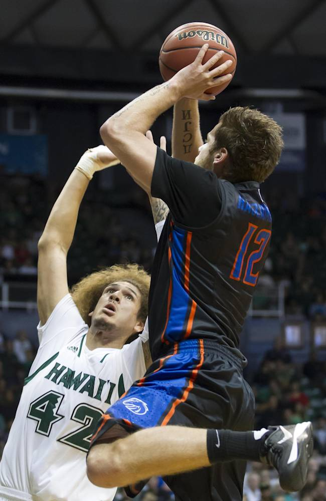 Boise State guard Igor Hadziomerovic (12) shoots the basketball over Hawaii forward Isaac Fotu (42) in the first half of an NCAA college basketball game at the Diamond Head Classic Sunday, Dec. 22, 2013, in Honolulu