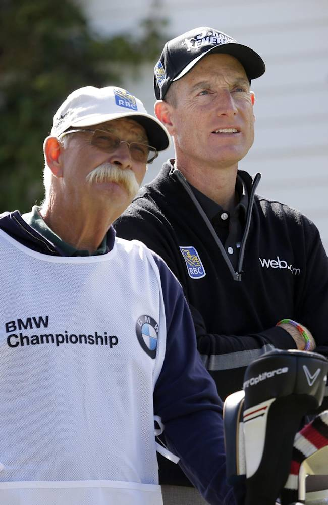 Jim Furyk, right and his caddie Mike