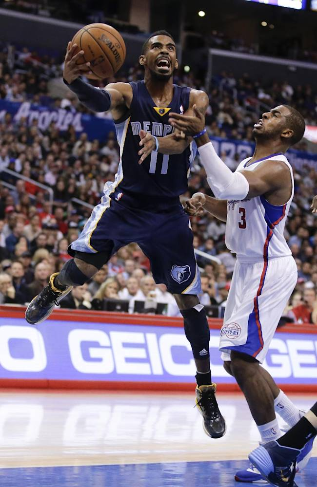 Memphis Grizzlies guard Mike Conley, left, drives to the basket past Los Angeles Clippers guard Chris Paul during the second half of an NBA basketball game in Los Angeles, Monday, Nov. 18, 2013