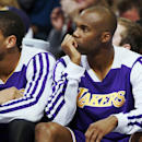 Los Angeles Lakers guards Xavier Henry, left, and Jodie Meeks watch their team from the bench as time runs out in the fourth quarter of the Denver Nuggets' 111-99 victory over the Lakers in an NBA basketball game in Denver on Wednesday, Nov. 13, 2013 The