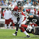 Arizona Cardinals wide receiver Michael Floyd (15) breaks tackles by Jacksonville Jaguars cornerback Will Blackmon (24), free safety Josh Evans, bottom, and outside linebacker Russell Allen, right, for a 91-yard touchdown in the second half of an NFL foot