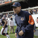 Chicago Bears head coach Marc Trestman runs onto the field during warmups before an NFL football game against the Miami Dolphins Sunday, Oct. 19, 2014 in Chicago. (AP Photo/Nam Y. Huh)