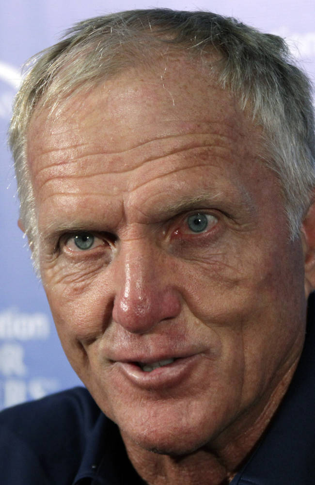 Greg Norman talks with reporters after finishing a pro-am event at the Fox Chapel Country Club in Fox Chapel, Pa., Wednesday, June 27, 2012. When Norman tees off on Thursday, in the Senior Players Championship golf tournament, he will be playing in his first Senior Players Championship event since 2009