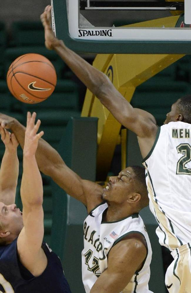 UAB's Rod Rucker and Tosin Mehinti (21) pressure Chattanooga's Martynas Bareika during the first half of an NCAA basketball game in Birmingham, Ala., Wednesday, Dec. 18, 2013