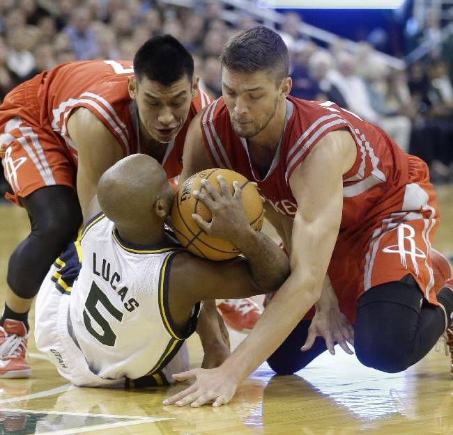 Utah Jazz's John Lucas III (5) battles with Houston Rockets Jeremy Lin, left, and teammate Chandler Parsons, right, for a loose ball  in the fourth quarter during an NBA basketball game Saturday, Nov. 2, 2013, in Salt Lake City. The Rockets defeated the Jazz 104-93