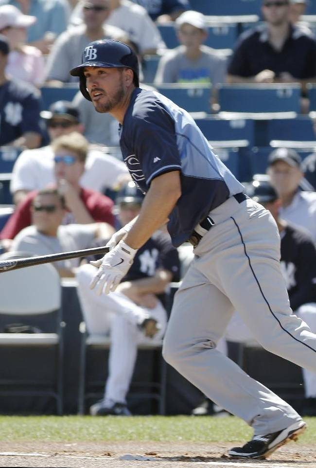 Tampa Bay Rays' Matt Joyce hits a double off New York Yankees starting pitcher David Phelps during a spring training baseball game in Tampa, Fla., Sunday, March 9, 2014