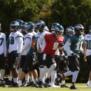 Philadelphia Eagles quarterback Nick Foles (9) and teammates move to their first drills during NFL football practice at the team's training facility, Tuesday, Sept. 23, 2014, in Philadelphia. The Associated Press