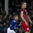 Everton's Ross Barkley, left, celebrates after scoring during the English Premier League soccer match between Everton and Queens Park Rangers at Goodison Park Stadium, Liverpool, England, Monday Dec. 15, 2014