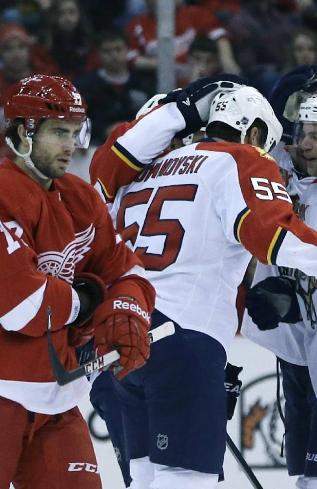 Detroit Red Wings right wing Patrick Eaves (17) skates by as Florida Panthers left wing Sean Bergenheim (20) of Finland is congratulated on his goal during the first period of an NHL hockey game in Detroit, Sunday, Jan. 26, 2014