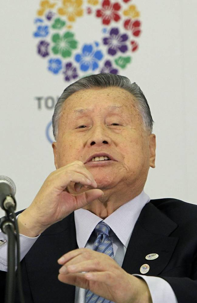 Former Japanese Prime Minister Yoshiro Mori asks a reporter to has her microphone away from her as he takes in a question at a press conference in Tokyo Friday, Jan. 24, 2014. Mori, 76, was officially appointed head of the Tokyo 2020 Summer Olympic organizing committee on Friday. Mori, 76, said,