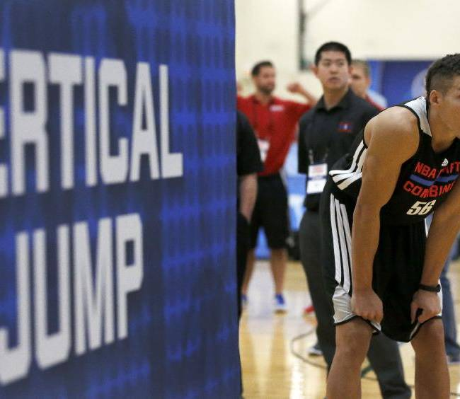 Aaron Gordon, from Arizona, waits to participate in the running vertical jump at the 2014 NBA basketball draft combine Friday, May 16, 2014, in Chicago