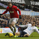 Manchester United s Wayne Rooney, left, is tackled by Tottenham Hotspur s Vlad Chiriches during their English Premier League soccer match at White Hart Lane, London, Sunday Dec. 1, 2013
