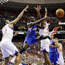 Los Angeles Clippers' Darren Collison, center, passes the ball against Philadelphia 76ers' Evan Turner, left, and Hollis Thompson during the first half of an NBA basketball game, Monday, Dec. 9, 2013, in Philadelphia The Associated Press