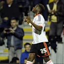 Fulham's Moussa Dembele celebrates scoring a goal during the English League Cup soccer match between Fulham and Derby County at Craven Cottage stadium in London, Tuesday, Oct. 28, 2014