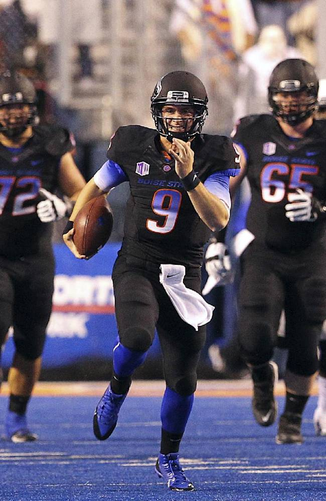 Boise State quarterback Grant Hedrick rushes for a long gain against Nevada during an NCAA college football game Saturday, Oct. 19, 2013, in Boise