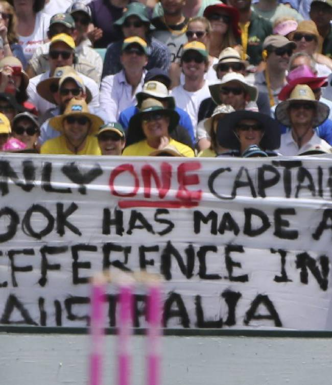 Australian cricket fans hold up a sign during Ashes cricket test match between Australia and England in Sydney, Australia, Friday, Jan. 3, 2014