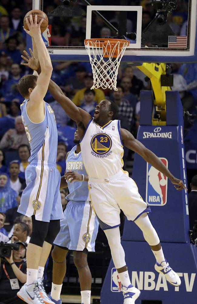 Golden State Warriors' Draymond Green, right, attempts to block the shot of Denver Nuggets' Timofey Mozgov during the first half of an NBA basketball game Thursday, April 10, 2014, in Oakland, Calif