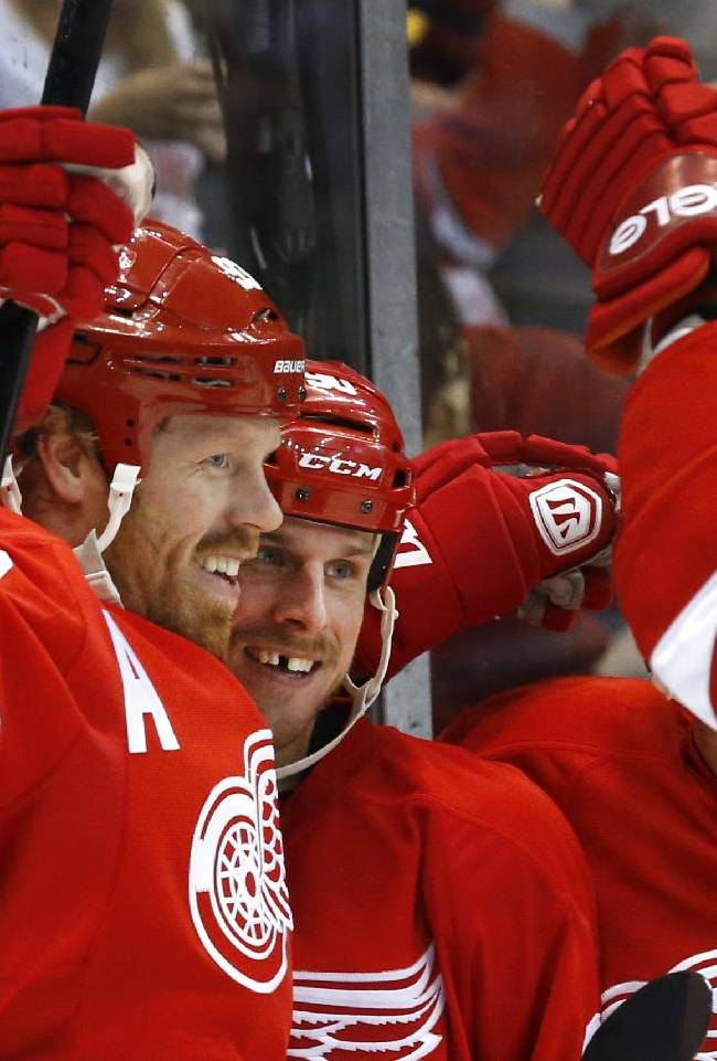 Detroit Red Wings left wing Johan Franzen (93), of Sweden, celebrates his goal against the Philadelphia Flyers with teammate Stephen Weiss, right, in the second period of an NHL hockey game in Detroit, Wednesday, Dec. 4, 2013