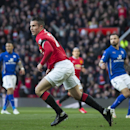 Manchester United's Robin van Persie, center left, celebrates after scoring against Leicester during the English Premier League soccer match between Manchester United and Leicester at Old Trafford Stadium, Manchester, England, Saturday Jan. 31, 2015