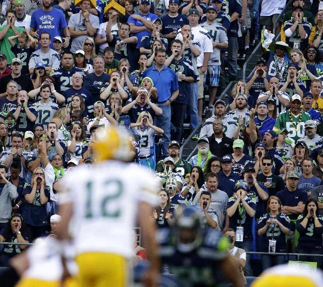 Seattle Seahawks fans yell as Green Bay Packers quarterback Aaron Rodgers (12) tries to call a play in the first half of an NFL football game, Thursday, Sept. 4, 2014, in Seattle