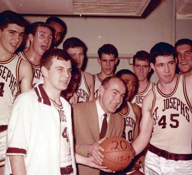 This undated photo provided by Saint Joseph's University shows the school's basketball coach Jack Ramsay, center, when his team won his 200th career game. Ramsay, a Hall of Fame coach who led the Portland Trail Blazers to the 1977 NBA championship before he became one of the league's most respected broadcasters, has died following a long battle with cancer. He was 89