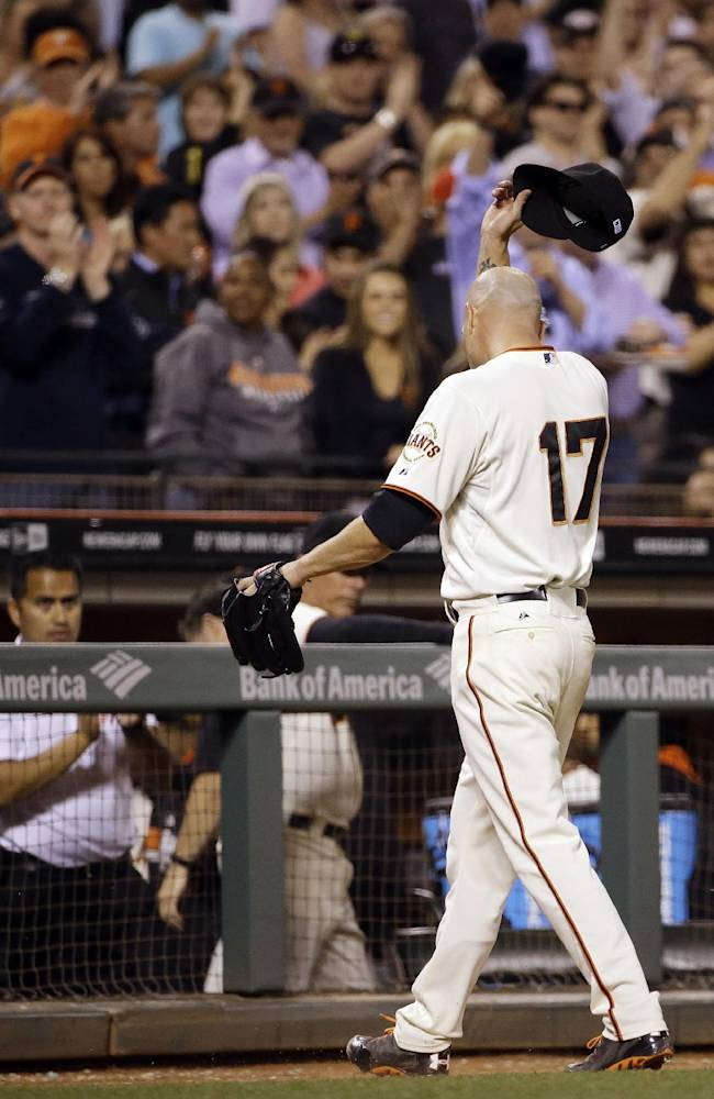 San Francisco Giants starting pitcher Tim Hudson tips his cap walking to the dugout after being removed in the ninth inning of a baseball game against the San Diego Padres Wednesday, April 30, 2014, in San Francisco. San Francisco won the game 3-2. (AP Photo)