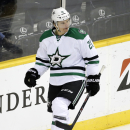 Dallas Stars left wing Antoine Roussel, of France, skates around the net after scoring against the Nashville Predators in the first period of an NHL hockey game Saturday, Oct. 11, 2014, in Nashville, Tenn The Associated Press