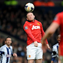 Manchester United's Wayne Rooney heads the ball during the English Premier League soccer match between West Bromwich Albion and Manchester United at The Hawthorns Stadium in West Bromwich, England, Saturday, March 8, 2014