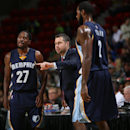 GREEN BAY, WI - OCTOBER 8: Head Coach David Joerger of the Memphis Grizzlies talks with Kalin Lucas #27 and Earl Clark #2 during the game against the Milwaukee Bucks on October 8, 2014 at Resch Center in Green Bay, Wisconsin. (Photo by Gary Dineen/NBAE via Getty Images)