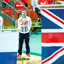 Aug 14, 2016; Rio de Janeiro, Brazil;  Silver medalist Callum Skinner (GBR), left, and gold medalist Jason Kenny (GBR) take the podium after competing in the men's cycling track sprint  at Rio Olympic Velodrome during the Rio 2016 Summer Olympic Games. . Mandatory Credit: Andrew P. Scott