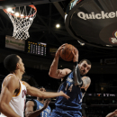 CLEVELAND, OH - FEBRUARY 11: Nikola Pekovic #14 of the Minnesota Timberwolves pulls down the rebound against Shaun Livingston #14 of the Cleveland Cavaliers at The Quicken Loans Arena on February 11, 2013 in Cleveland, Ohio. (Photo by David Liam Kyle/NBAE via Getty Images)