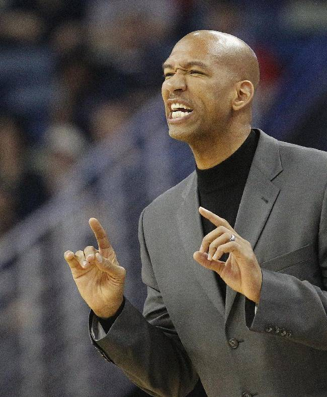 New Orleans Pelicans head coach Monty Williams yells to his team in the first half of an NBA basketball  against the Los Angeles Clippers in New Orleans, Monday, Feb. 24, 2014