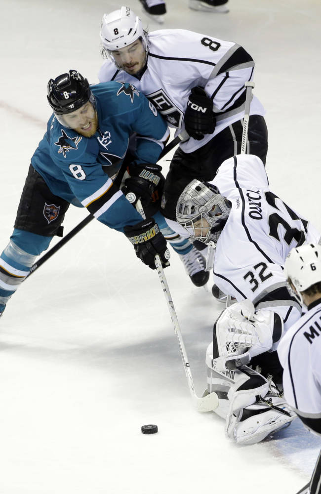 Los Angeles Kings goalie Jonathan Quick (32) stops a shot from San Jose Sharks' Joe Pavelski (8)  during the third period of an NHL hockey game on Monday, Jan. 27, 2014, in San Jose, Calif. Los Angeles won 1-0
