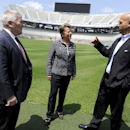 Penn State President Eric Barron, new athletic director Sandy Barbour and football coach James Franklin talk on the field of Beaver Stadium in State College, Pa. on Saturday, July 26, 2014. Penn State has hired Barbour as athletic director, a month after