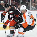 The Ducks' Rene Bourque battles for the puck with the Flyers' Pierre-Edouard Bellemare during the second period Wednesday night Dec. 3, 2014 at the Honda Center The Associated Press