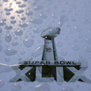 Raindrops cover Super Bowl logo on a table outside the University of Phoenix Stadium Thursday, Jan. 29, 2015, in Glendale, Ariz. The New England Patriots face the Seattle Seahawks in Super Bowl XLIX at the venue on Sunday The Associated Press
