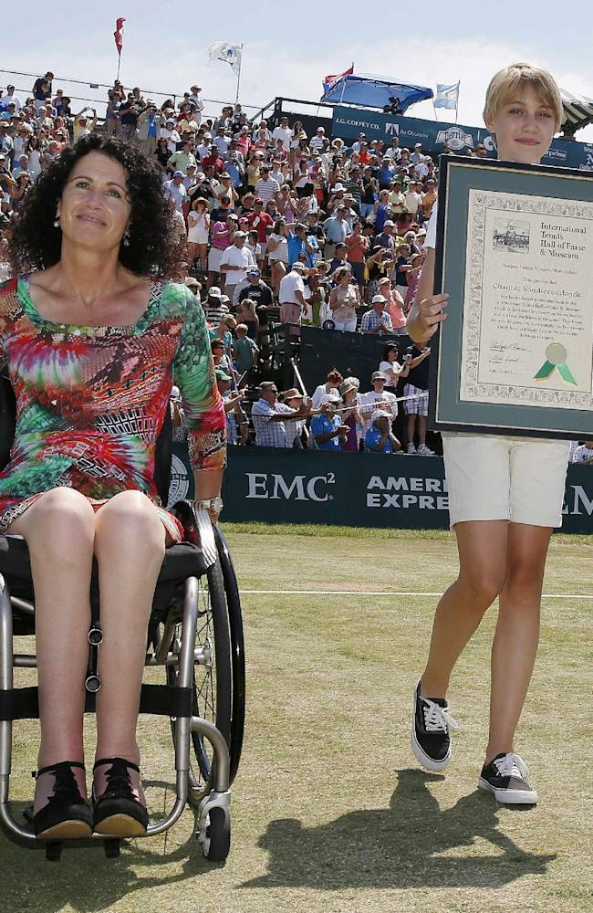Chantal Vandierendonck, left, of the Netherlands, makes the rounds of the stadium with her plaque after being inducted into the International Tennis Hall of Fame in Newport, R.I., Saturday, July 12, 2014