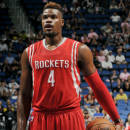ORLANDO, FL - OCTOBER 22: Jeff Adrien #4 of the Houston Rockets attempts a free throw against the Orlando Magic on October 22, 2014 at Amway Center in Orlando, Florida. (Photo by Fernando Medina/NBAE via Getty Images)