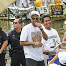 SAN ANTONIO, TX - JUNE 18: Tony Parker of the San Antonio Spurs participates in a victory parade and celebration after winning the 2014 NBA Championship on June 18, 2014 in San Antonio, Texas. (Photo by Layne Murdoch Jr./NBAE via Getty Images)