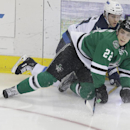 Dallas Stars center Colton Sceviour (22) and Winnipeg Jets defenseman Tobias Enstrom (39) of Sweeden look at the puck after they fell to the ice during the first period of an NHL hockey game Monday, March 24, 2014, in Dallas The Associated Press
