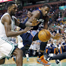 Boston Celtics' Jeff Green (8) an Charlotte Bobcats' Michael Kidd-Gilchrist (14) battle for a loose ball in the first quarter of an NBA basketball game in Boston, Friday, April 11, 2014 The Associated Press