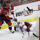 Washington Capitals' Joel Ward (42) and Phoenix Coyotes' Oliver Ekman-Larsson (23) vie for control of the puck during the third period of an NHL hockey game, Saturday, March 8, 2014, in Washington. The Capitals won 3-2 The Associated Press