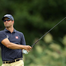 Adam Scott, of Australia, watches his tee shot on the fifth hole during second round play at The Barclays golf tournament Friday, Aug. 22, 2014, in Paramus, N.J. (AP Photo/Adam Hunger)