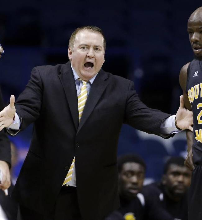 In this Nov. 13, 2013 file photo, Southern Mississippi head coach Donnie Tyndall, center, talks to guards Neil Watson, left, and Jerrold Brooks during the first half of an NCAA college basketball game against DePaul, in Rosemont, Ill. Tennessee is counting on Tyndall to make the same successful transition from the mid-major ranks as the Volunteers' last two men's basketball coaches. Tennessee announced Tuesday morning, April 22, 2014, that Tyndall would be introduced as its new coach at a 2 p.m. news conference